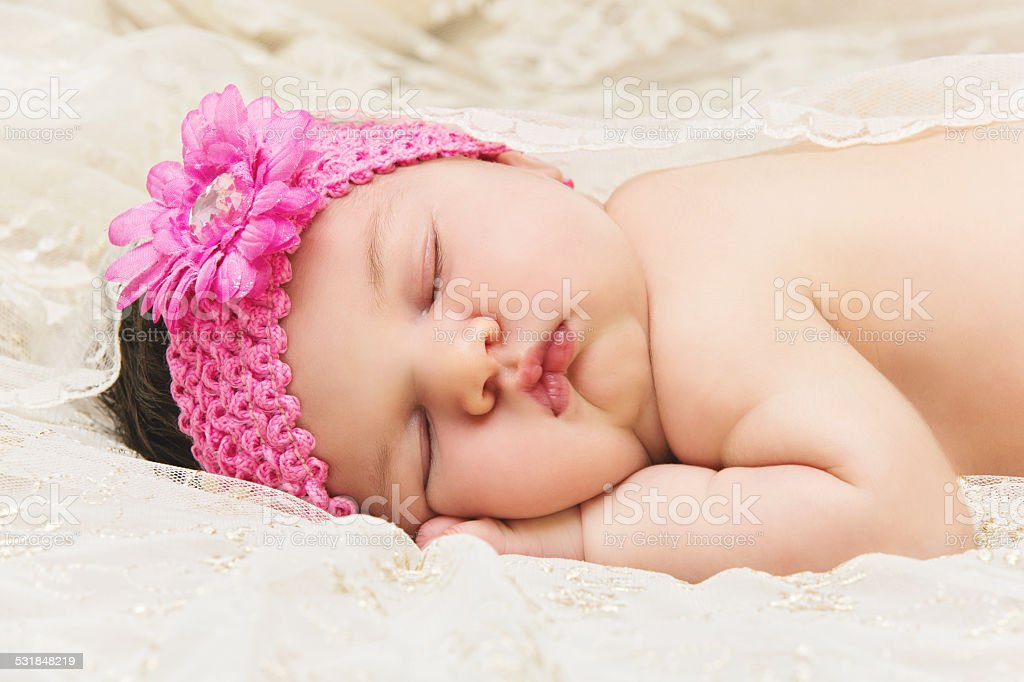 Baby sleeping on stomach stock photo