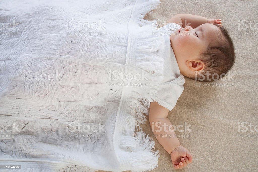 A baby sleeping stock photo