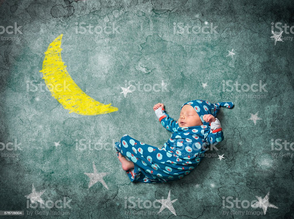 baby sleeping with the stars stock photo