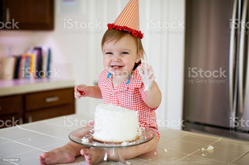 Baby Smashing a Cake stock photo