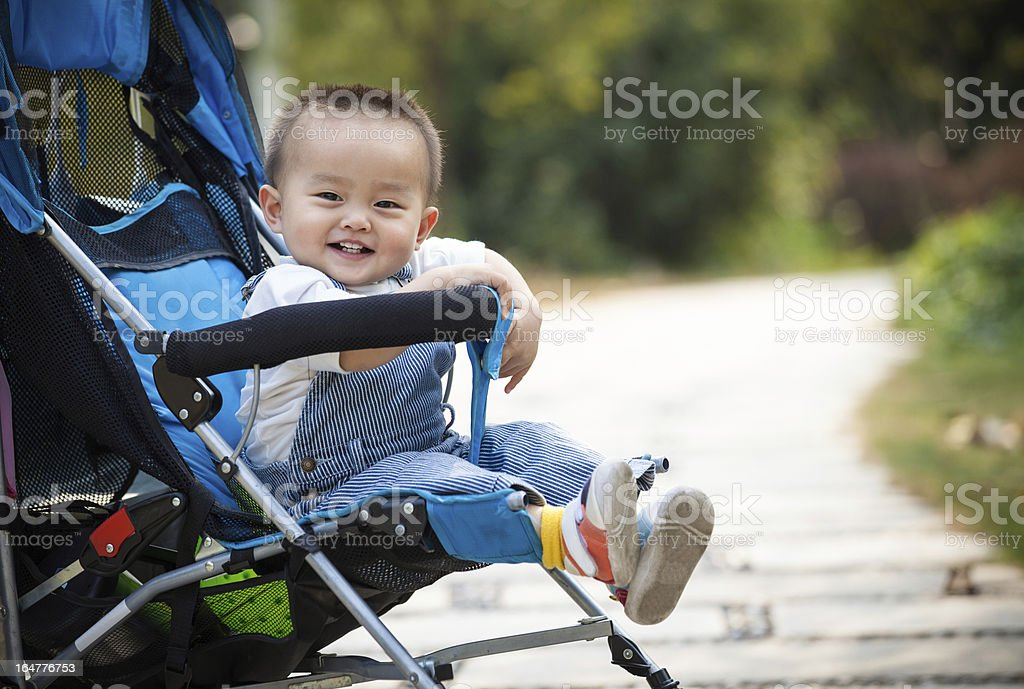 Baby smiling sitting stroller stock photo