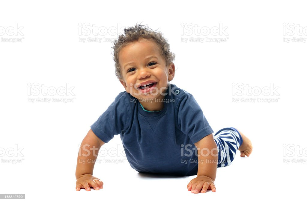 Baby Smiling While Attempting To Get Up From Lying Position stock photo