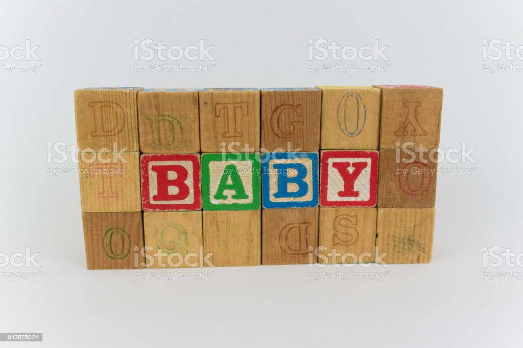 Baby Spelled in Blocks on a White Background stock photo