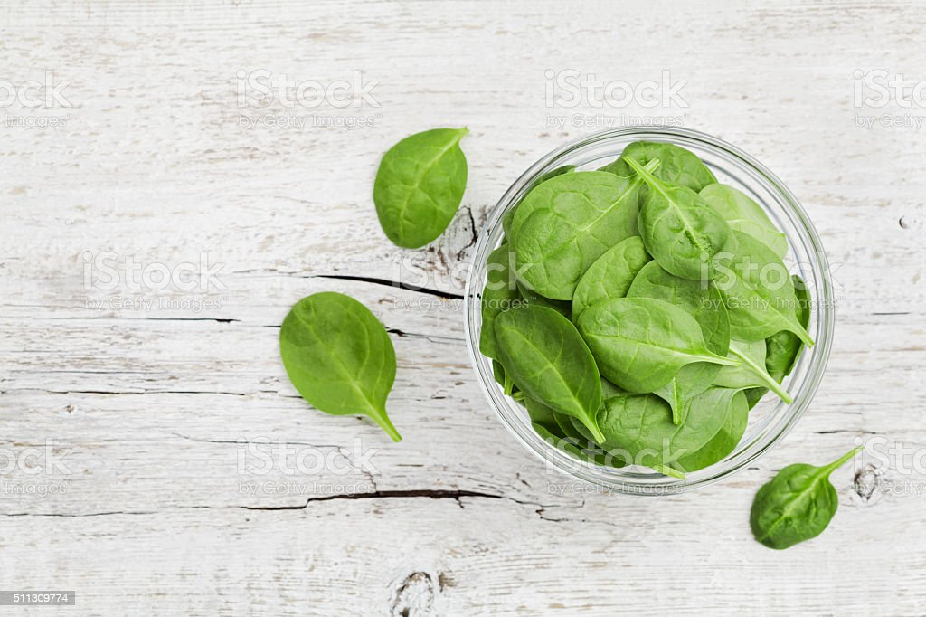 Baby spinach leaves, copy space for text, top view stock photo