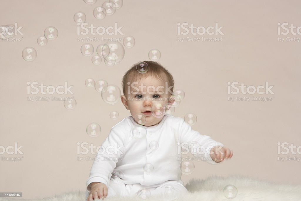 A baby surrounded by bubbles royalty-free stock photo