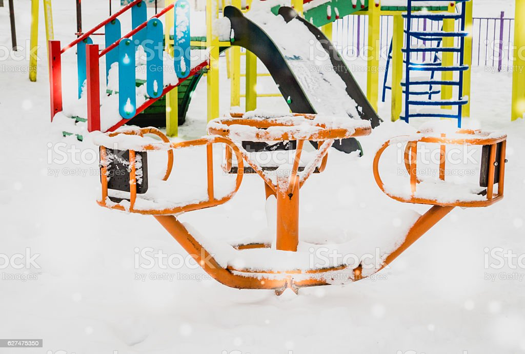 Baby swing and winter Park stock photo