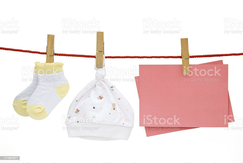 baby things and blank note hanging with clipping path royalty-free stock photo
