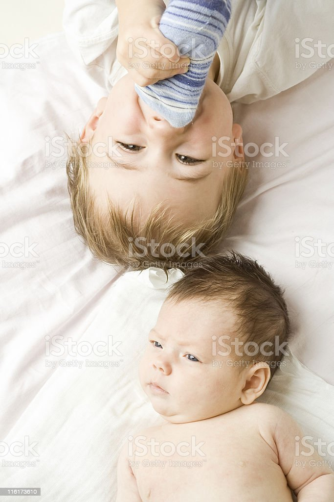 Baby & Toddler Laying Down stock photo