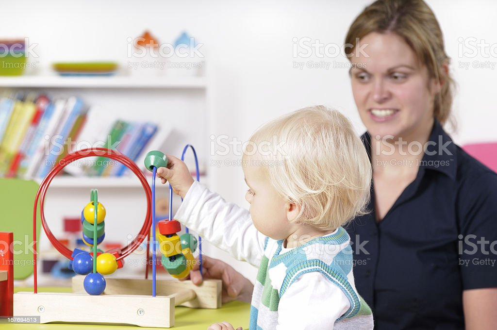 Baby/ Toddler Learning To Count Through Play stock photo