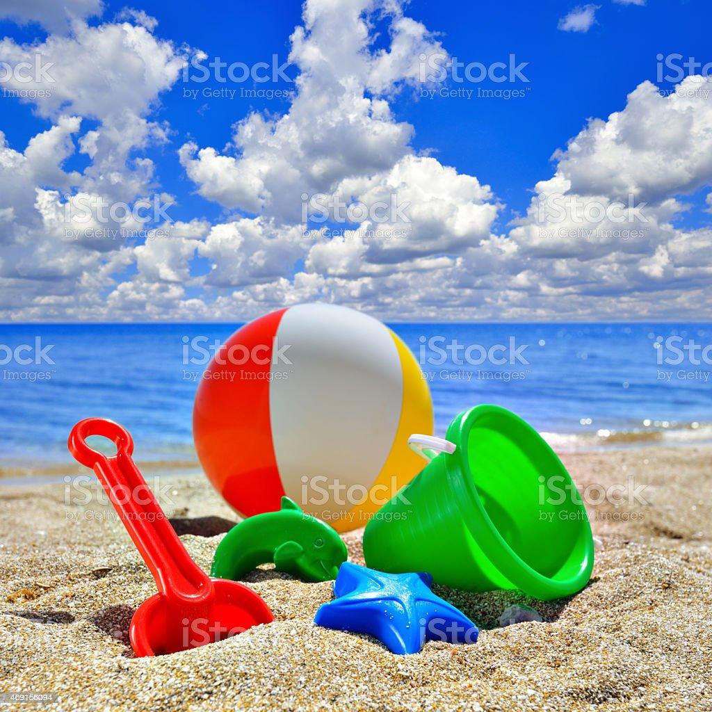 Baby Toys on beach sand stock photo