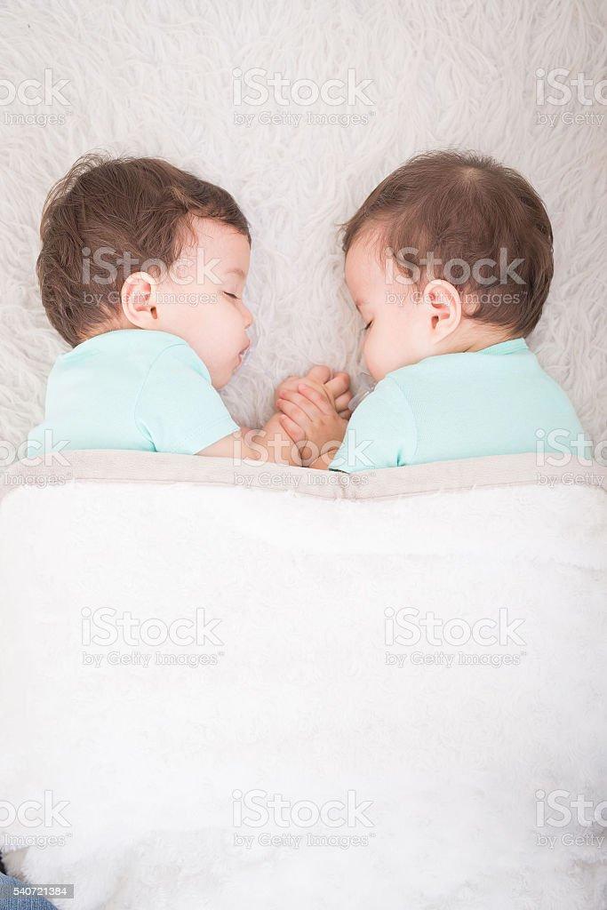 baby twins sleeping stock photo