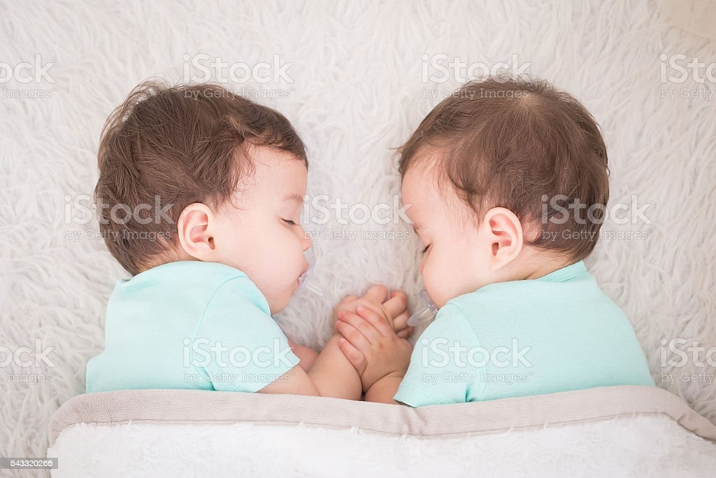 baby twins sleeping stock photo