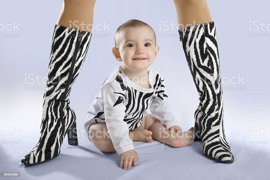 Baby under mothers protection stock photo