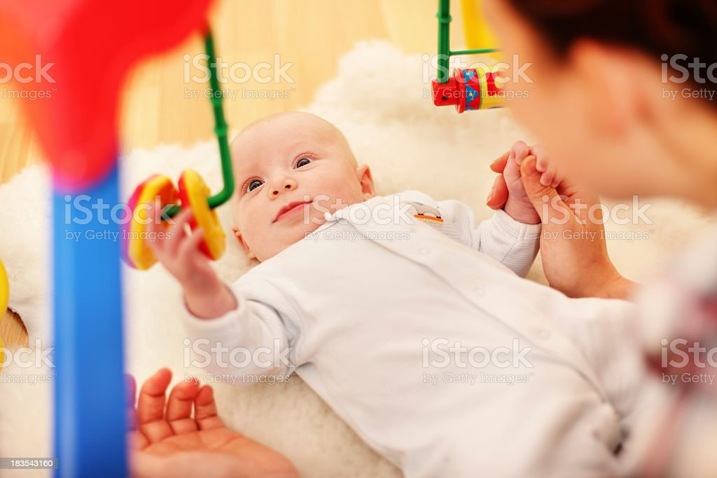 Baby using fine motor skills to play royalty-free stock photo