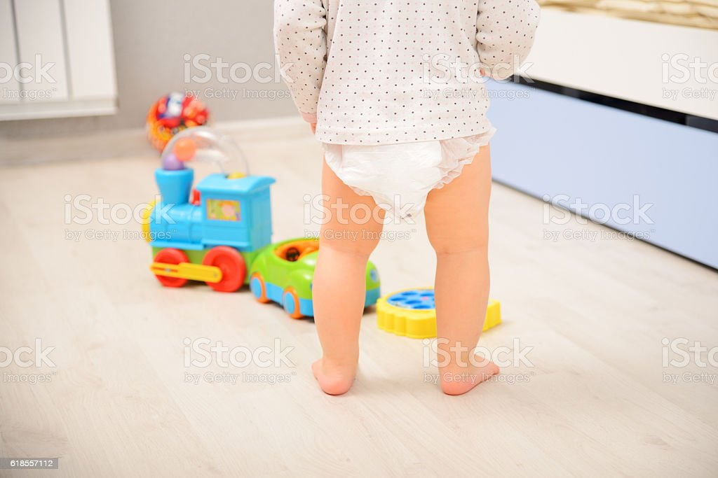 Baby walking in diaper stock photo