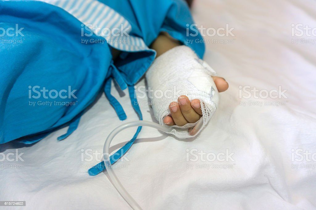 baby was lying in the hospital and was given saline. stock photo