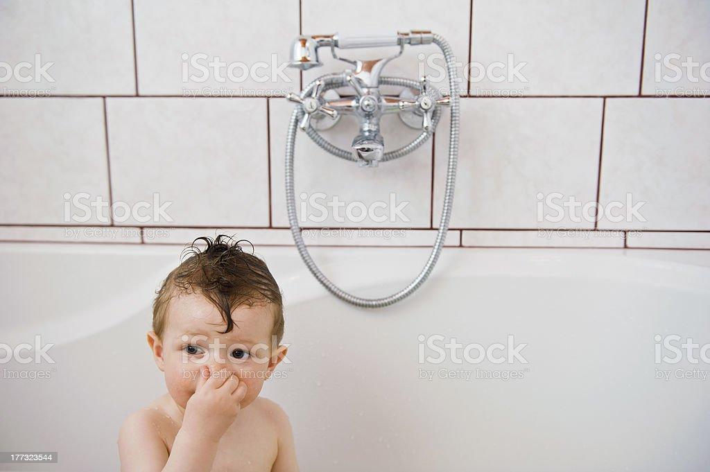 Baby washing in the bath. stock photo
