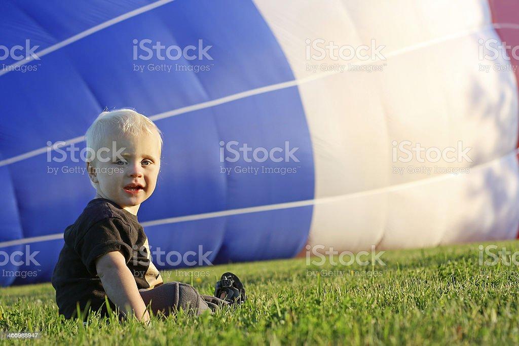 Baby Watching Hot Air Balloon Fill royalty-free stock photo