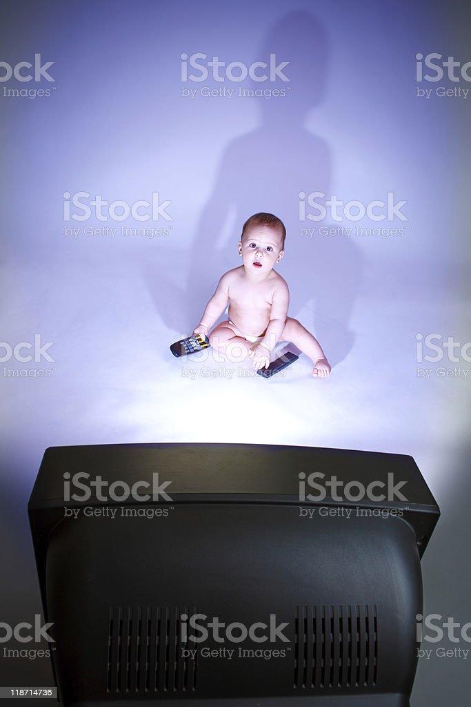 Baby watching TV royalty-free stock photo