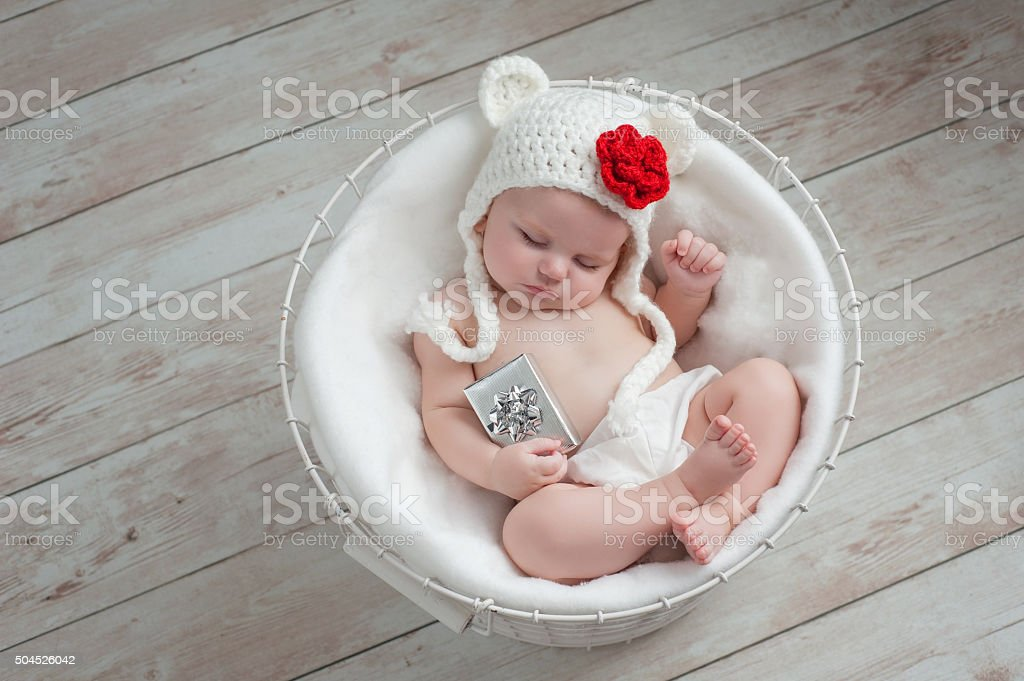 Baby Wearing a Christmas Bear Hat stock photo