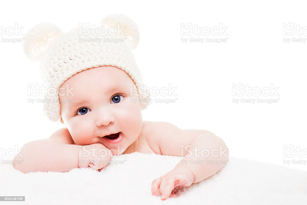 Baby wearing a knit hat with bear ears stock photo