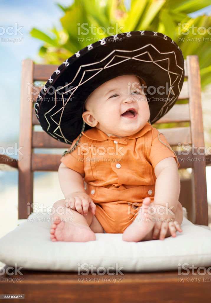 Baby wearing a mexican sombrero stock photo