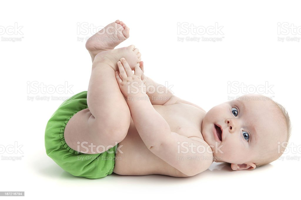 Baby Wearing Cloth Diaper Lying on White Floor stock photo