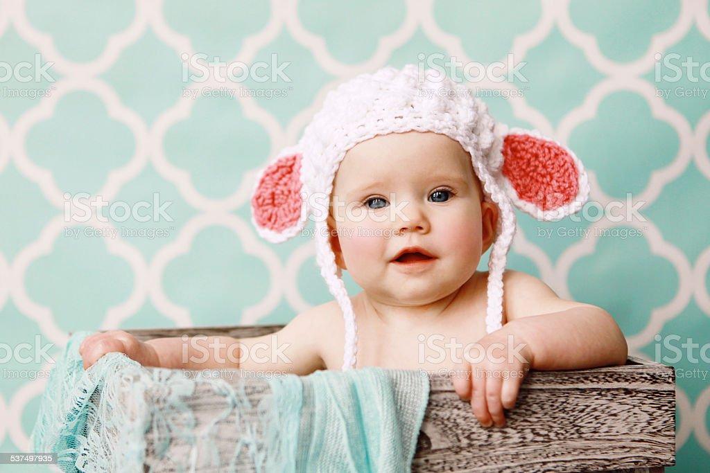 Baby Wearing Lamb Hat stock photo