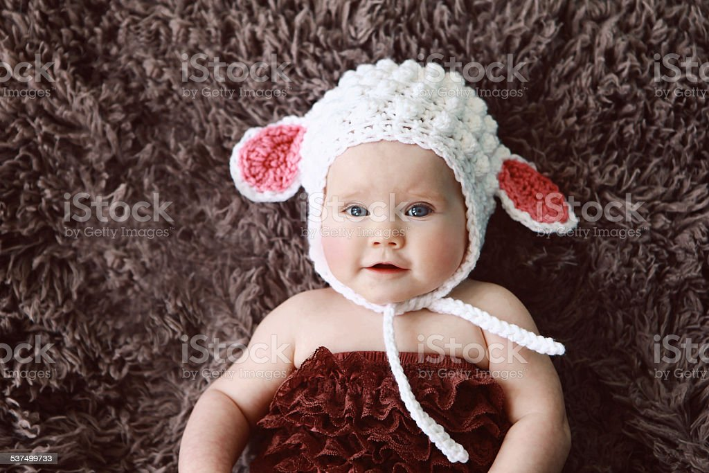 Baby Wearing Lamb Hat stock photo