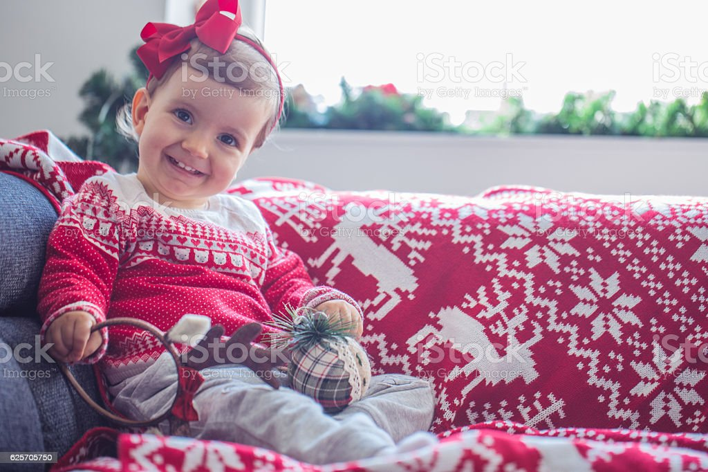 Baby who loves the holidays stock photo