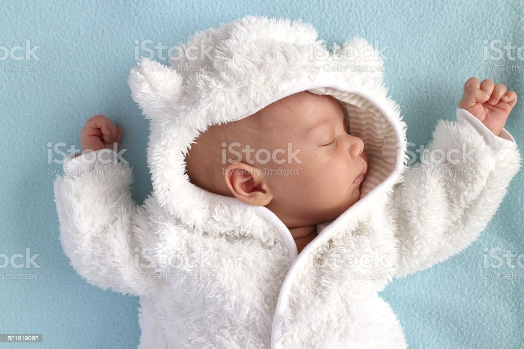 Baby winter teddy bear snow suit stock photo
