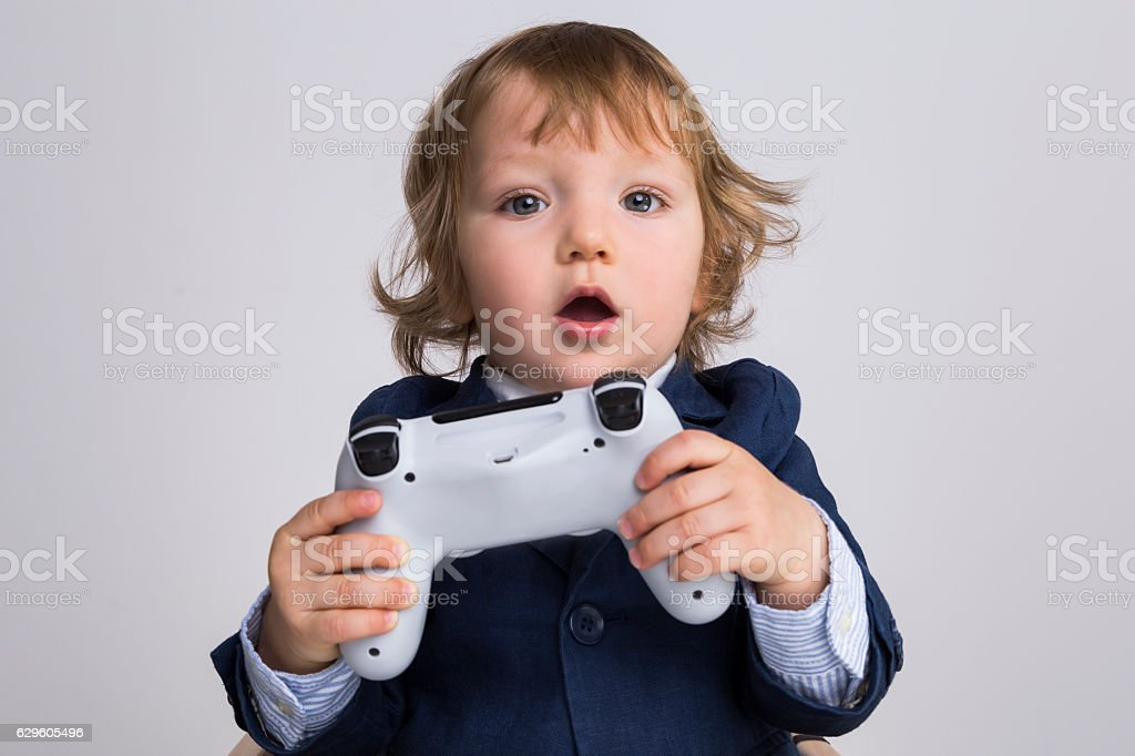 Baby with a game controller stock photo