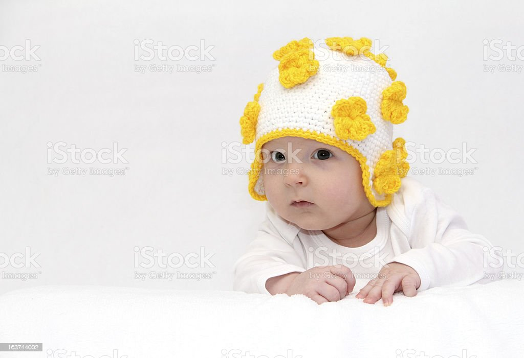 Baby with a knitted hat royalty-free stock photo