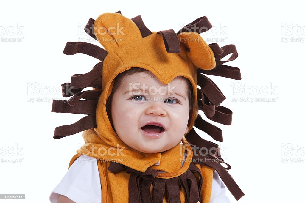 Baby with a lion mask royalty-free stock photo