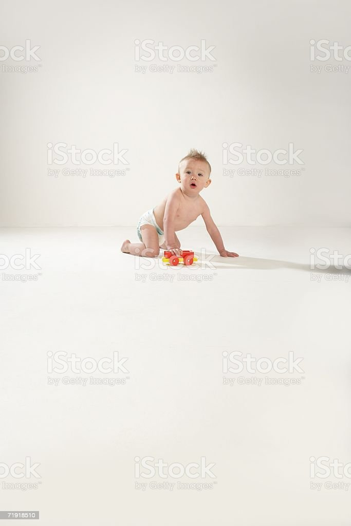 Baby with a toy train stock photo