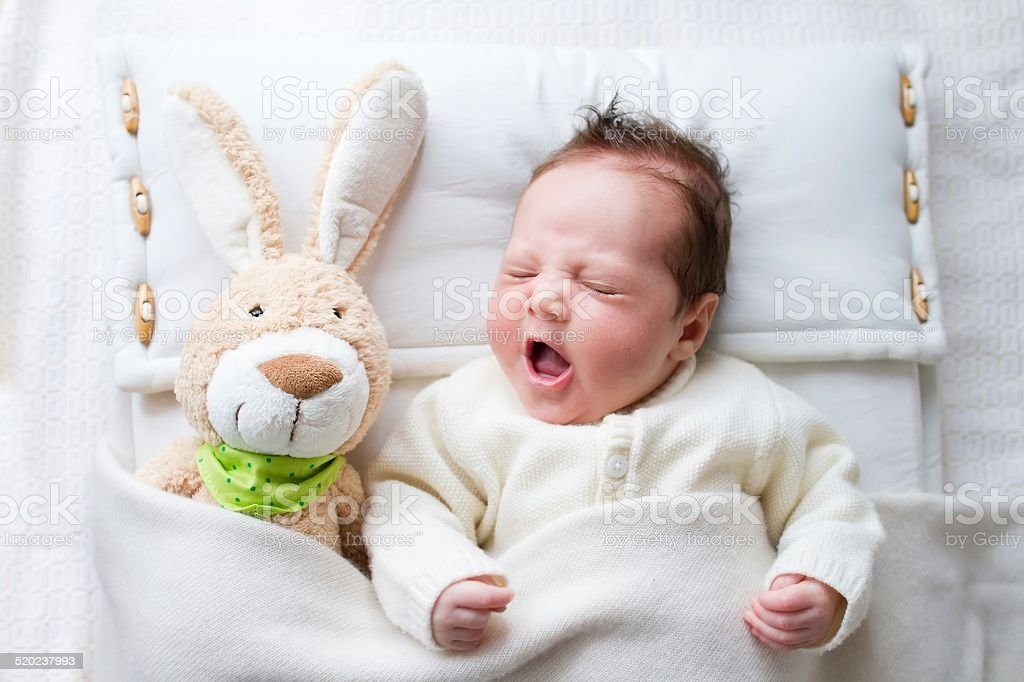 Baby with bunny stock photo