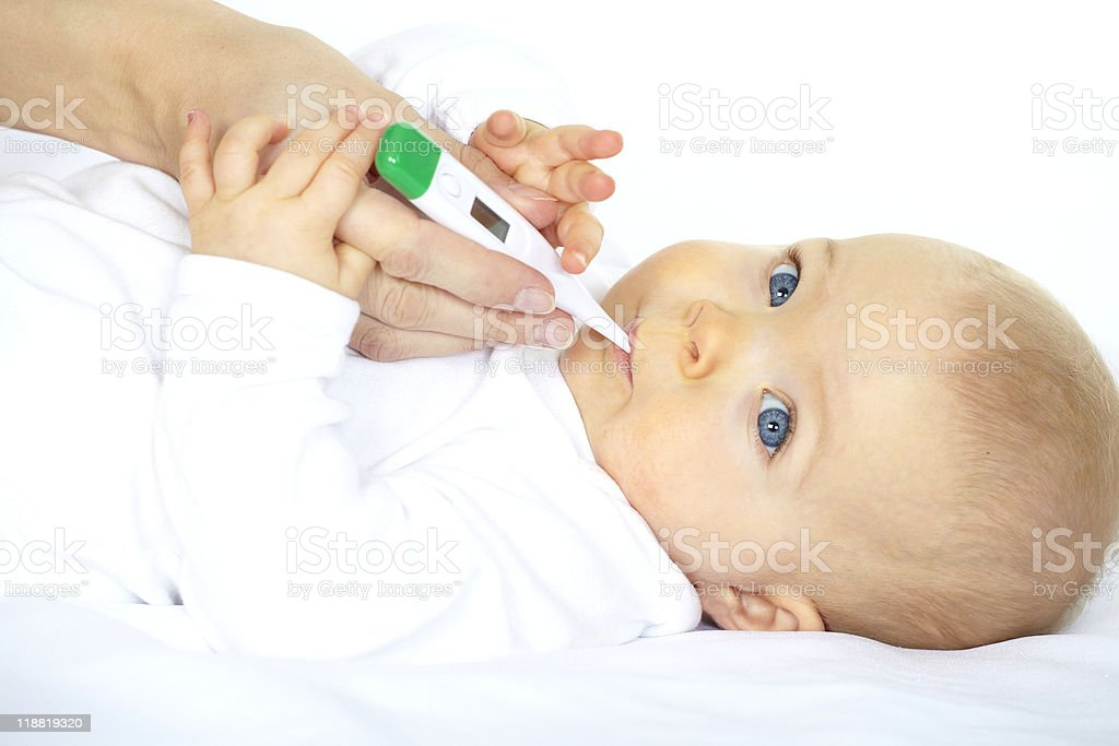 baby with clinical thermometer stock photo