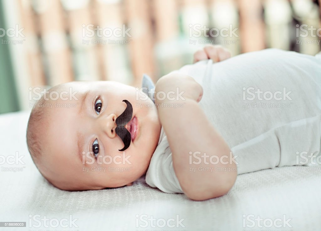 Baby with fake mustache stock photo