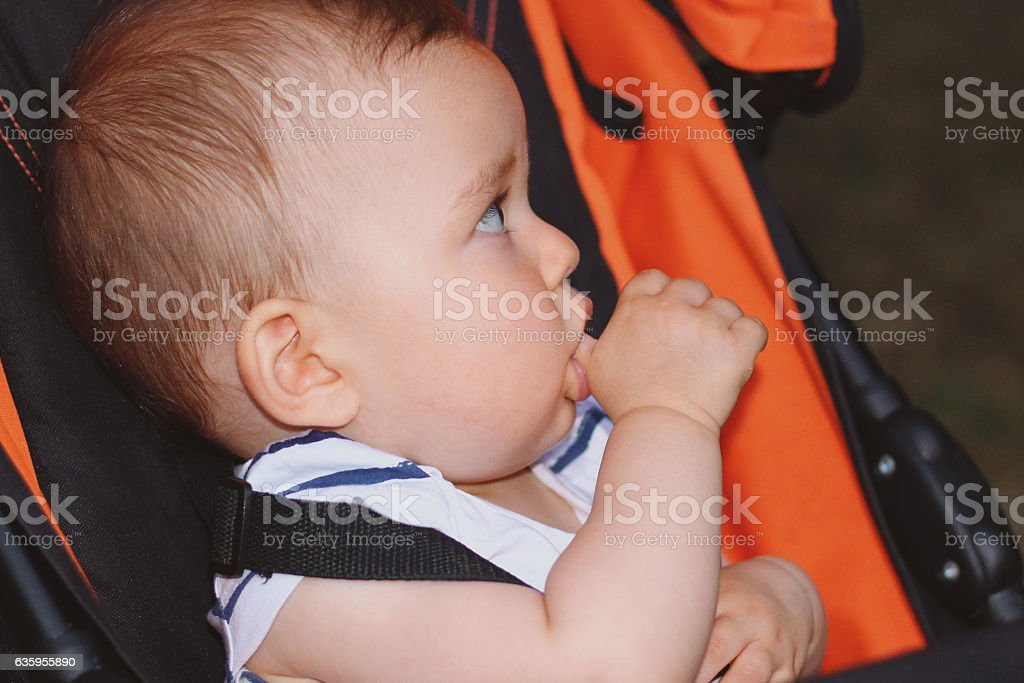 Baby with finger in her mouth stock photo