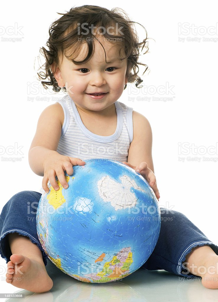 Baby with globe puzzle. royalty-free stock photo