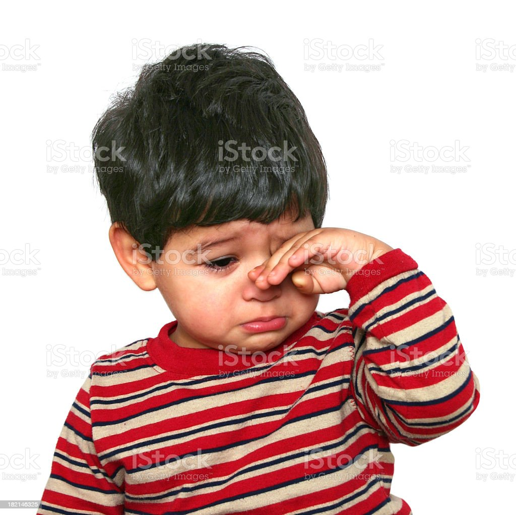 Baby with hand on face feeling sad stock photo