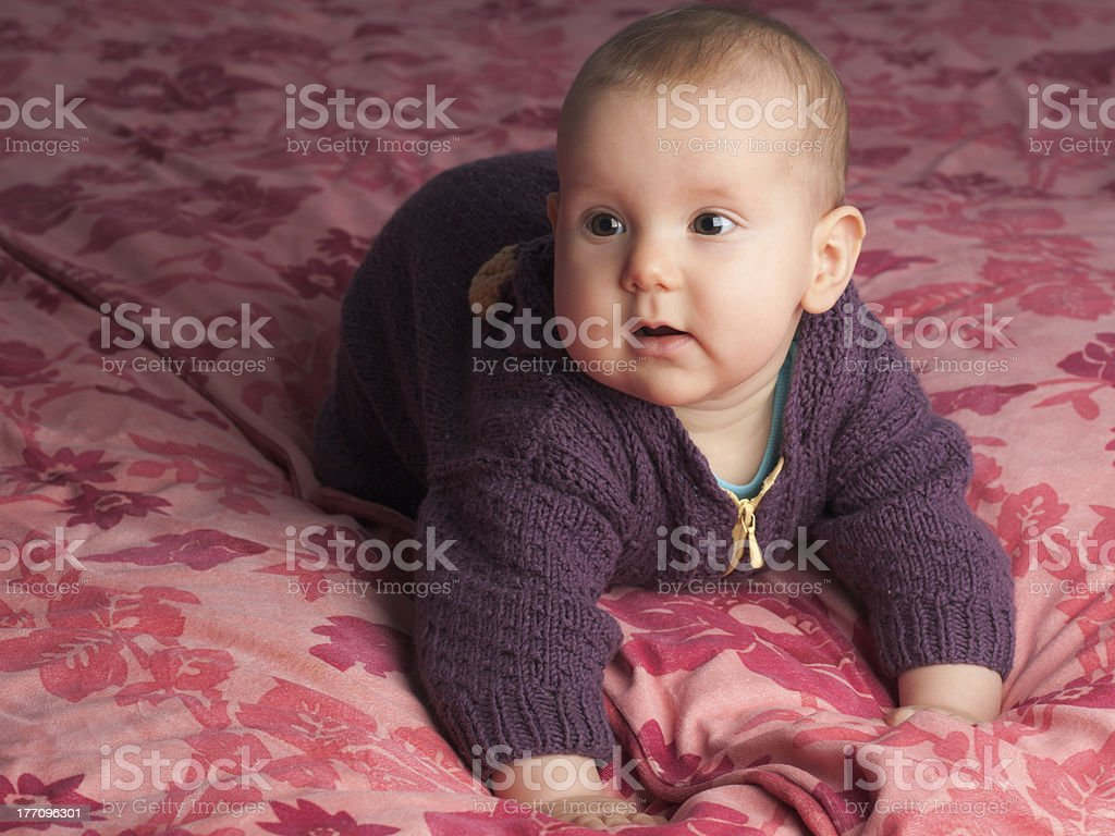 Baby with handknitted pyjama. royalty-free stock photo