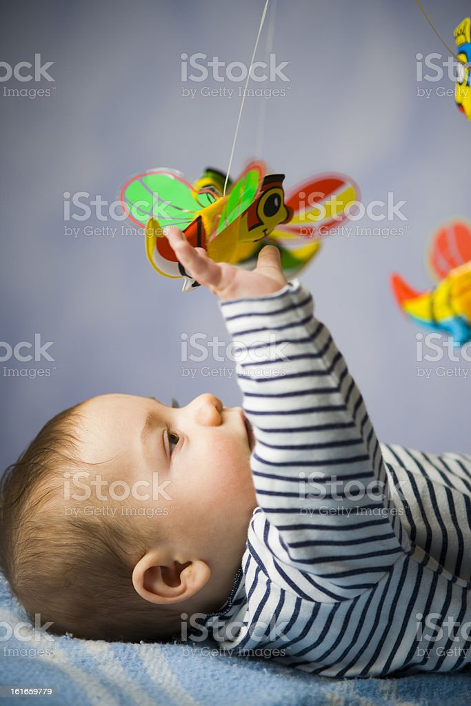 baby with hanging toy stock photo