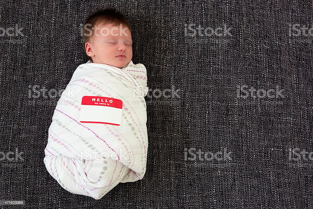 Baby with name tag stock photo