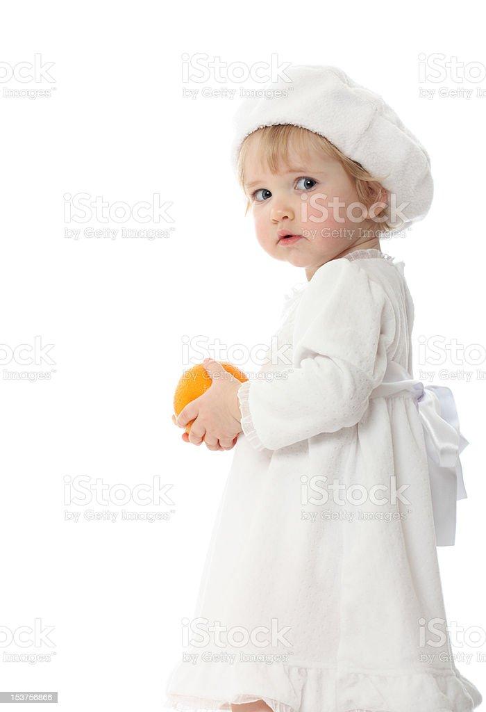 Baby with orange isolated on white royalty-free stock photo