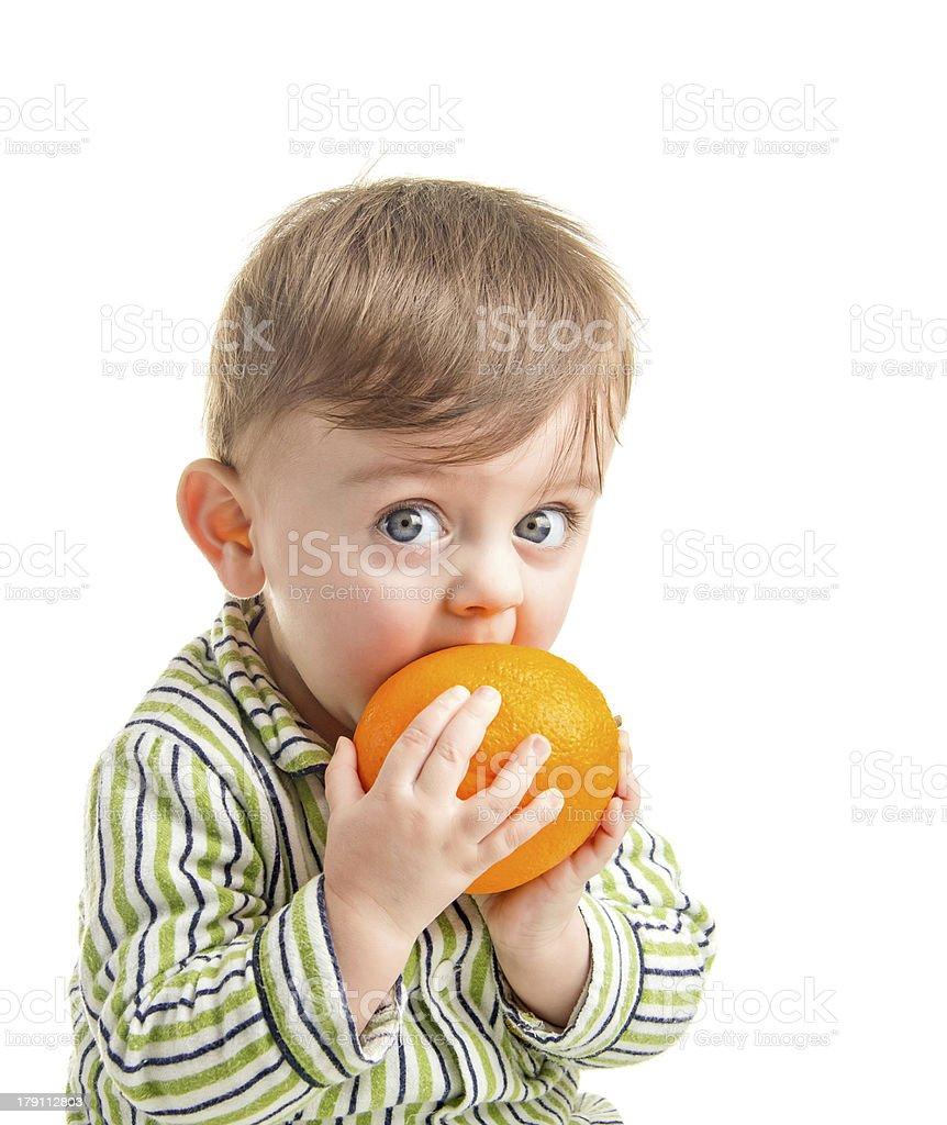 Baby with orange stock photo