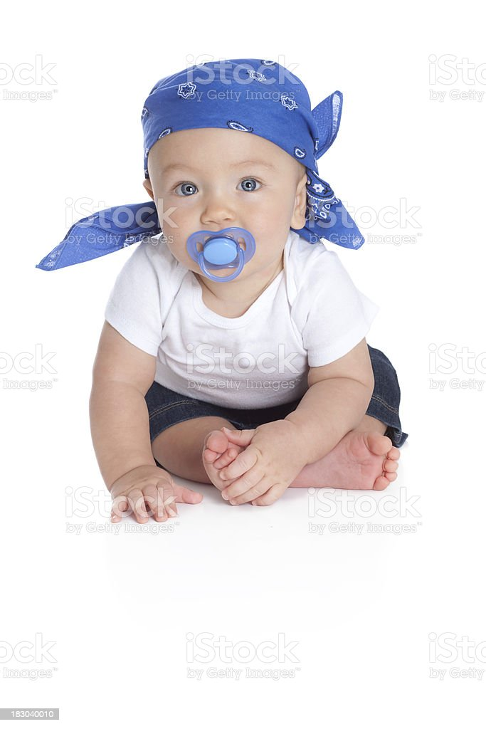 Baby with Pacifier and Wearing Bandana Scarf on Head royalty-free stock photo