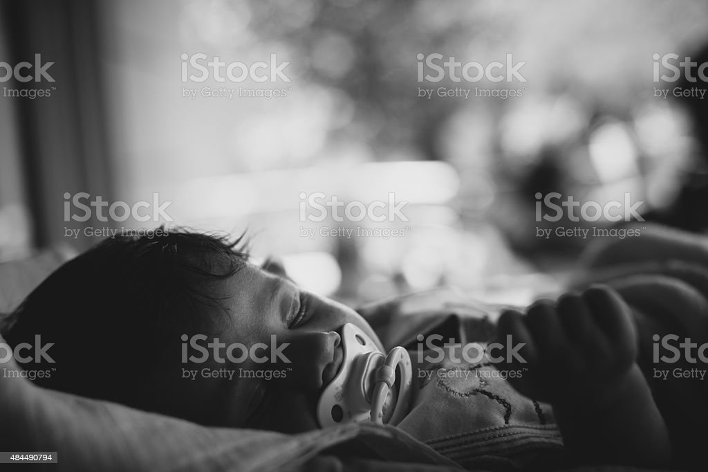 Baby with pacifier slepping stock photo