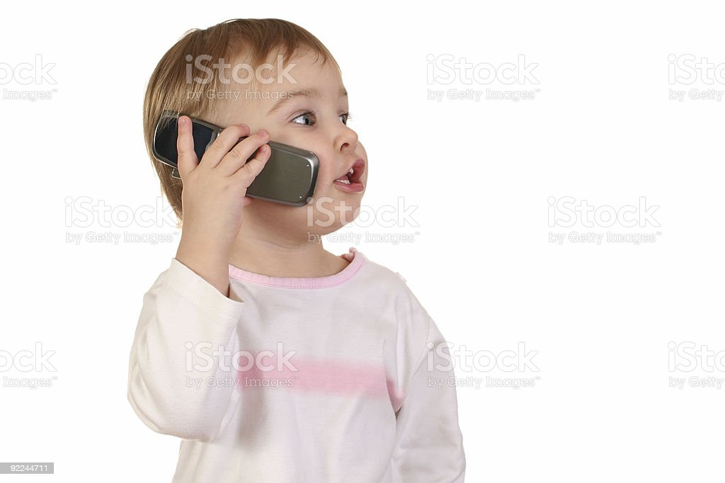 baby with phone stock photo