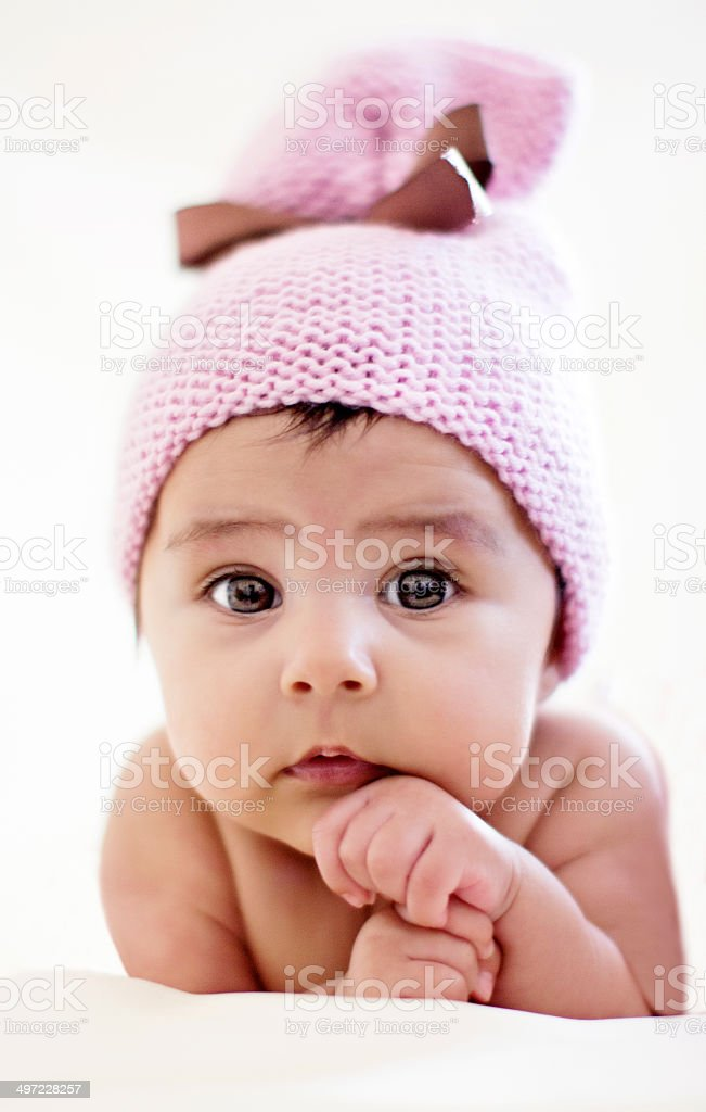 Baby with pink beret stock photo